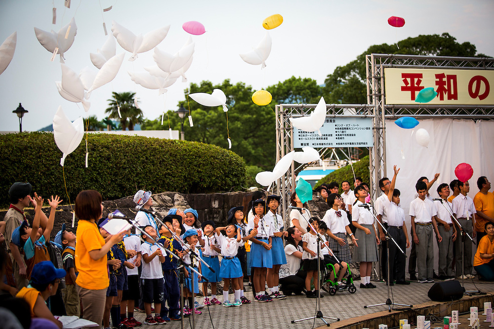 NAGASAKI, JAPAN - AUGUST 8 : Children release dove and heart shaped balloons for the victims of the atomic bombing on the eve ahead of the 71st anniversary activities, commemorating the atomic bombing of Nagasaki on August 8, 2016 in Nagasaki, southern Japan. On August 9, 1945, during World War II, the United States dropped the second Atomic bomb on Nagasaki city and killing an estimated 40,000 people which ended the World War II. (Photo by Richard Atrero de Guzman/NURPhoto)