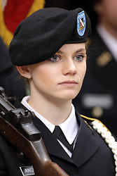 29 November 2014: A female ROTC honor guardsman carries a rifle as part of the flag ceremony during an NCAA men's basketball game between the Youngstown State Penguins and the Illinois State Redbirds  in Redbird Arena, Normal IL.