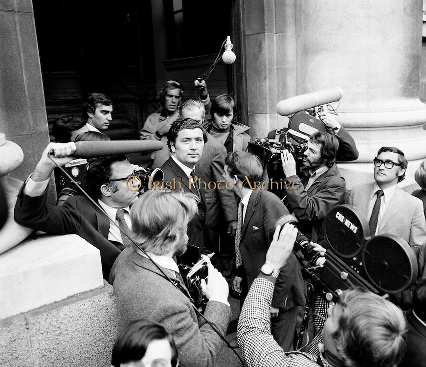 John Hume MP and Austin Curry MP (side to camera) are surrounded by the media as they arrive at Government Buildings as part of a Northern Ireland delegation to Taoiseach Jack Lynch.<br /> 23/08/1971