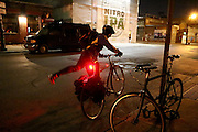 NEW YORK CITY, NEW YORK, MARCH 30, 2016. Caryn Havlik gets on her bicycle after Metal Bones Yoga is finished. The class takes place at 6:30 p.m. on Wednesdays at The Cobra Club in Bushwick, Brooklyn. 03/30/2016. Photo by Donna M. Airoldi/NYC News Service