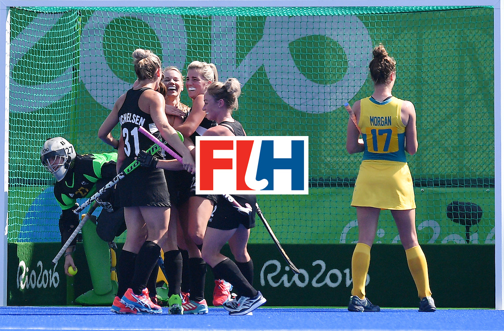 New Zealand's players celebrate their second goal during the the women's quarterfinal field hockey New Zealand vs Australia match of the Rio 2016 Olympics Games at the Olympic Hockey Centre in Rio de Janeiro on August 15, 2016. / AFP / Carl DE SOUZA        (Photo credit should read CARL DE SOUZA/AFP/Getty Images)