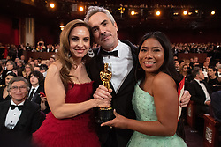 Alfonso Cuaron, Oscar® winner, poses with Marina de Tavira (L) and Yalitza Aparicio pose during the live ABC Telecast of The 91st Oscars® at the Dolby® Theatre in Hollywood, CA on Sunday, February 24, 2019.