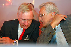BRUSSELS, BELGIUM - AUGUST-6-2007 - Fortis Chief Executive Officer, Jean-Paul Votron, and Executive Member of the Fortis Board of Directors, Herman Verwilst, confer with one another before the start of an extraordinary shareholders meeting at the Bozar Center in Brussels, Monday August 6, 2007. (Photo © Jock Fistick)