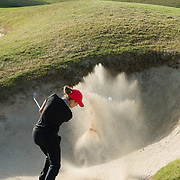 26 March 2018: Haleigh Krause chips out of the bunker on the seventh hole during the opening round of the March Mayhem Tournament hosted by SDSU at the Farms Golf Club in Rancho Santa Fe, California. <br /> More game action at sdsuaztecphotos.com