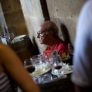 An old local man sits at the door of a bar of the Plaza Nueva Square in the Northern Spanish Basque city of Bilbao, on August 25, 2011. Photo Rafa Rivas