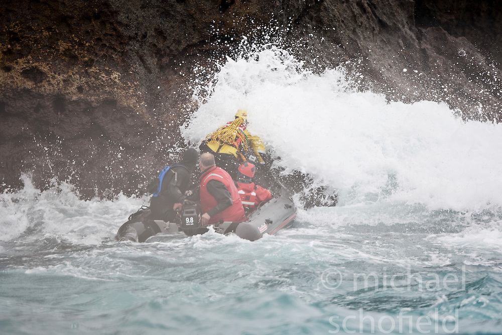 Nick Hancock (yellow) trying again to get on Rockall, for his reconnaissance mission for a future 60 day occupation of Rockall. The Rockall Jubilee Expedition, a unique endurance expedition to be undertaken by Nick, in order to raise funds for Help for Heroes .©Michael Schofield..