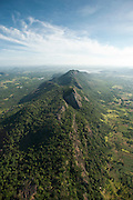 Aerial view of mountain ridge covered in forest.