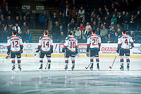 KELOWNA, CANADA - FEBRUARY 18: Tyrell Goulbourne #12, Rourke Chartier #14, Nick Merkley #10, Devante Stephens #21 and Madison Bowey #4 of Kelowna Rockets stand on the ice during the national anthem against the Kamloops Blazers on February 18, 2015 at Prospera Place in Kelowna, British Columbia, Canada.  (Photo by Marissa Baecker/Shoot the Breeze)  *** Local Caption *** Tyrell Goulbourne ; Rourke Chartier; Nick Merkley; Devante Stephens; Madison Bowey;
