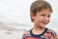 Smiling boy (5-6) on beach