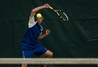 Tyler Hanf of Gilford returns a shot during NHIAA Division III semi final tennis with Kearsarge at Gilford Hills Club on Friday afternoon.  (Karen Bobotas/for the Laconia Daily Sun)