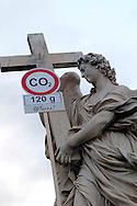 """Roma 5 Giugno 2008.  <br /> L' Associazione ambientalista  """"Terra""""  per protesta contro l'emissione di CO2, ha applicato  su 150 statue di Roma  mascherine antinquinamento e cartelli contro il CO2.Statua a Ponte Sant'Angelo<br /> Rome June 5, 2008.  <br /> L 'Environmental association """"Earth"""" in protest against the emission of CO2, has applied to 150 statues of Rome anti-pollution masks and poster against the CO2."""