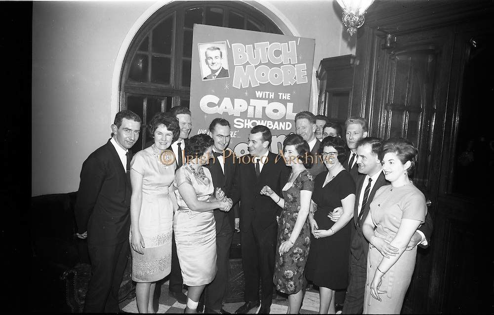 03/02/1964<br /> 02/03/1964<br /> 03 February 1964 <br /> Capitol Show Band and Pye Records reception for single 'Foolin' Time' at Country Club Portmarnock. Image shows group of Record Dealers with Butch Moore, congratulating him on excellent record, (l-r) Front Row: Tony Fay; Mrs Joe O'reilly; Miss Joan Smyth; Butch Moore; Miss Anne Flynn; Mrs J. Wine; Noel Synott and Mrs Marie de Labre. At rear: Jim Doherty; John Woods; Joe O'Reilly, Paddy Murray