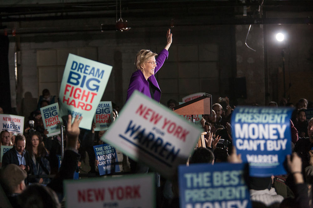 "Long Island City, NY – 8 March 2019. Massachusetts Senator and Democratic Presidential candidate Elizabeth Warren drew an enthusiastic crowd at an organizing rally for her 2020 presidential campaign in Long Island City. Enthusiastic supporters wave signs reading ""Dream Big Fight Hard"" and ""The Best President Money Can't Buy."""