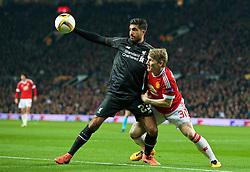MANCHESTER, ENGLAND - Wednesday, March 16, 2016: Liverpool's Emre Can in action against Manchester United's Bastian Schweinsteiger during the UEFA Europa League Round of 16 2nd Leg match at Old Trafford. (Pic by David Rawcliffe/Propaganda)