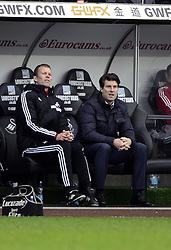 Swansea City Manager, Michael Laudrup watches from the bench - Photo mandatory by-line: Joe Meredith/JMP - Tel: Mobile: 07966 386802 19/01/2014 - SPORT - FOOTBALL - Liberty Stadium - Swansea - Swansea City v Tottenham Hotspur - Barclays Premier League