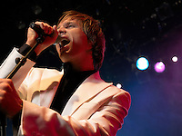 Young Man Singing into microphone on stage at Concert low angle view