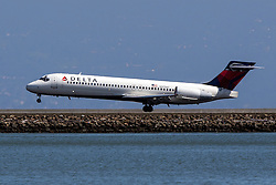 Delta Boeing 717-200 (N979AT) lands at San Francisco International Airport (SFO), Millbrae, California, United States of America