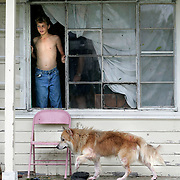 "Port Arthur, TX / 2005 - Randy Henry, 15, of 2305 Avenue ""A"" looks for rescue workers a few hours after Hurricane Rita passed through the city. Photo by Mike Roy/The Monitor"