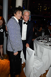 Left to right, RONNIE WOOD and MICHAEL DOUGLAS at the GQ Men of The Year Awards 2013 in association with Hugo Boss held at the Royal Opera House, London on 3rd September 2013.