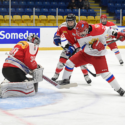WHITBY, - Dec 15, 2015 -  WJAC Game 6- Team Russia vs Team Switzerland at the 2015 World Junior A Challenge at the Iroquois Park Recreation Complex, ON. Artur Kayumov #24 of Team Russia battles for the puck with Matteo Ritz #30 and Philipp Kurashev #23 of Team Switzerland during the first period.<br /> (Photo: Andy Corneau / OJHL Images)