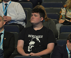 A fan wearing a t shirt with a picture of Margaret Thatcher and the slogan 'what would Maggie do' waits for Home Secretary Priti Patel to deliver her keynote seech at the Conservative Party conference in Manchester.<br /> <br /> © Dave Johnston / EEm