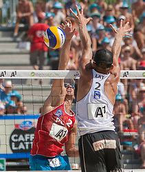 04.08.2013, Klagenfurt, Strandbad, AUT, A1 Beachvolleyball EM 2013, Halbfinale Herren, Spiel 69, im Bild hinten Grzegorz FIJALEK 2 POL, vorne Janis Smedins 2 LAT // during mens seminfinals match 69 of the A1 Beachvolleyball European Championship at the Strandbad Klagenfurt, Austria on 2013/08/04. EXPA Pictures © 2013, EXPA Pictures © 2013, PhotoCredit: EXPA/ Mag. Gert Steinthaler