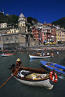 2000, Vernazza, Italy --- Man Rowing in Vernazza Harbor --- Image by © Owen Franken/CORBIS