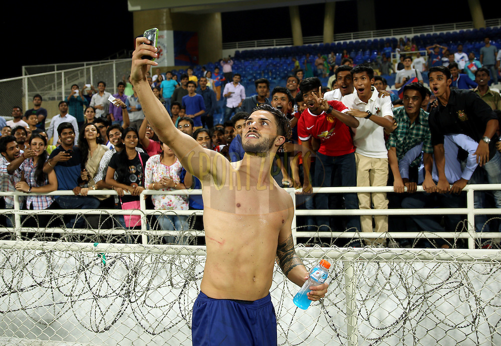 Tiago Ribeiro of Mumbai City FC meets the fan after the match 52 of the Hero Indian Super League between Mumbai City FC and Atletico de Kolkata held at the D.Y. Patil Stadium, Navi Mumbai, India on the 7th December 2014.<br /> <br /> Photo by:  Sandeep Shetty/ ISL/ SPORTZPICS