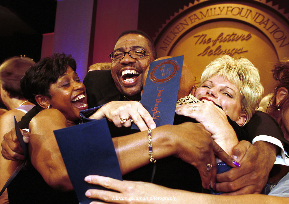 Recipients of the Milken National Educator Awards celebrate after receiving their checks for $25,000, in Los Angeles. From left, Dee Fox, and Marcellus Hankins, teachers from Oklahoma and Jean Brassfield, principal from Oklahoma. The Milken National Educator Awards were presented to 155 recipients from across the nation, to provide public recognition and financial awards to outstanding elementary and secondary school teachers, principals and other education professionals who are furthering excellence in education. Photo/Milken Family Foundation, Susan Goldman.