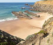 Sandy beach Praia dos Alteirinhos, Zambujeira do Mar,  in bay between rocky headlands at Parque Natural do Sudoeste Alentejano e Costa Vicentina, Costa Vicentina natural park, Zambujeira do Mar, Alentejo Littoral, Portugal, southern Europe
