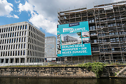 View of new canal side office and luxury apartment buildings under construction at new Europacity property development in Berlin Germany