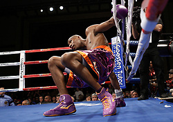 Dec 5, 2009; Atlantic City, NJ, USA; Paul Williams gets knocked down by Sergio Martinez during their welterweight bout at the Adrian Phillips Ballroom in Atlantic City, NJ.