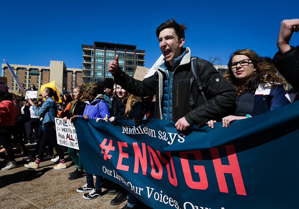High school student leaders direct the crowds of marchers outside the State Capitol in support of stronger gun regulation and legislation in Madison, Wisconsin, Wednesday, March 14, 2018.