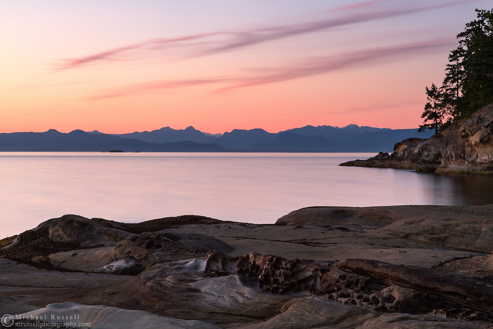 A sunset over the Coast Mountain Range and Nanaimo Harbour from Biggs Park/Jack Point/Duke Point in Nanaimo, British Columbia, Canada