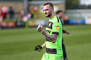 Forest Green Rovers Carl Winchester(7) applauds the fans at the final whistle during the EFL Sky Bet League 2 match between Forest Green Rovers and Cambridge United at the New Lawn, Forest Green, United Kingdom on 22 April 2019.