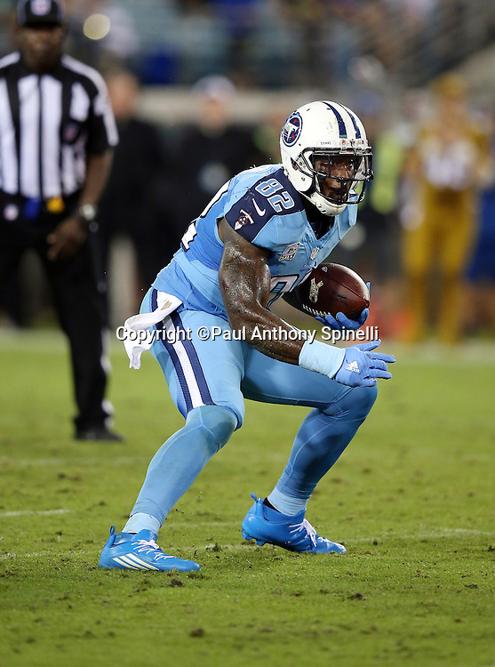Tennessee Titans tight end Delanie Walker (82) runs with the ball after catching a pass during the 2015 week 11 regular season NFL football game against the Jacksonville Jaguars on Thursday, Nov. 19, 2015 in Jacksonville, Fla. The Jaguars won the game 19-13. (©Paul Anthony Spinelli)