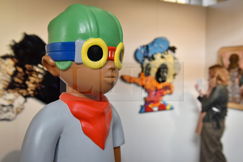 """© Licensed to London News Pictures. 06/10/2017. London, UK.  A character called """"The Juniors: Kirby"""", 2017, by Hebru Brantley at the Moniker Art Fair, the world's biggest urban art fair, taking place at the Old Truman Brewery in East London from 5 to 8 October 2017.  The fair brings together the world's most influential new-contemporary and urban art galleries to show international artworks to Londoners. Photo credit : Stephen Chung/LNP"""