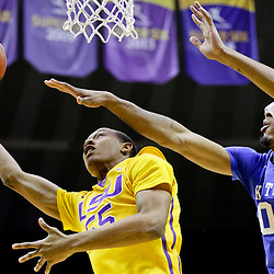 Jan 5, 2016; Baton Rouge, LA, USA; LSU Tigers guard Tim Quarterman (55) shoots over Kentucky Wildcats forward Marcus Lee (00) during the first half of a game at the Pete Maravich Assembly Center. Mandatory Credit: Derick E. Hingle-USA TODAY Sports