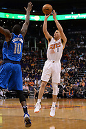 Apr 9, 2017; Phoenix, AZ, USA; Phoenix Suns guard Devin Booker (1) shoots the ball in front of Dallas Mavericks forward Dorian Finney-Smith (10) in the second half of the NBA game at Talking Stick Resort Arena. The Suns won 124-111. Mandatory Credit: Jennifer Stewart-USA TODAY Sports