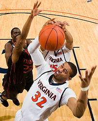 Virginia forward Mike Scott (32) grabs a rebound against Miami.  The Virginia Cavaliers fell to the Miami Hurricanes 62-55 at the John Paul Jones Arena on the Grounds of the University of Virginia in Charlottesville, VA on February 26, 2009.
