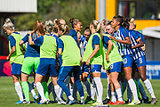 Brighton & Hove Albion FC huddle before the FA Women's Super League match between Brighton and Hove Albion Women and Chelsea at The People's Pension Stadium, Crawley, England on 15 September 2019.
