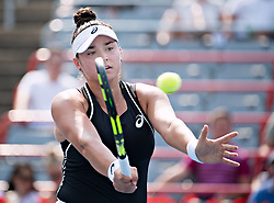 MONTREAL, Aug. 7, 2018  Caroline Dolehide of the United States hits a return during the first round of women's singles match against Venus Williams of the United States at the 2018 Rogers Cup in Montreal, Canada, Aug. 6, 2018. Venus Williams won 2-0. (Credit Image: © Andrew Soong/Xinhua via ZUMA Wire)