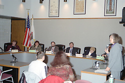Debate between candidates for the Normal Illinois Town Council sponsored by the League of Women Voters at the Normal Town Hall.<br /> <br /> <br /> This image was scanned from a slide, print, negative or transparency.  Image quality may vary.  Dust and other unwanted artifacts may exist.