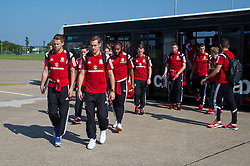 CARDIFF, WALES - Sunday, September 7, 2014: Wales players Chris Gunter and Aaron Ramsey board the plane at Cardiff Airport as the squad flies to Andorra ahead of the opening UEFA Euro 2016 qualifying match. (Pic by David Rawcliffe/Propaganda)