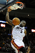Feb 4, 2010; Cleveland, OH, USA; Miami Heat guard Dwyane Wade (3) goes up for a dunk during the second quarter against the Cleveland Cavaliers at Quicken Loans Arena. Mandatory Credit: Jason Miller-US PRESSWIRE