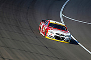 NASCAR Sprint Cup Series driver Kevin Harvick (4) heads into turn one during the Hollywood Casino 400 at Kansas Speedway in Kansas City, Kan., Sunday, Oct. 5, 2014. (AP Photo/Colin E. Braley)