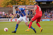 Carlisle United defender Michael Raynes beats York City forward Vadaine Oliver during the Sky Bet League 2 match between York City and Carlisle United at Bootham Crescent, York, England on 19 September 2015. Photo by Simon Davies.
