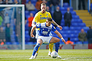 Birmingham City forward Che Adams shields the ball from Leeds United defender Pontus Jansson (18)  during the EFL Sky Bet Championship match between Birmingham City and Leeds United at St Andrews, Birmingham, England on 6 April 2019.