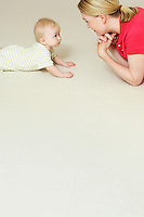 Mother and child lying on floor