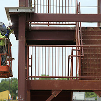 A welder secures a cover on a beam of the stairway on the west end of the new student services building being constructed on the ICC Tupelo campus Tuesday afternoon.